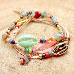 Oorbellen en armbandjes met schelpjes