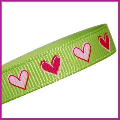 Lint 10 mm limoen groen met roze hartjes per meter