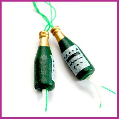 Gelukspoppetje van hout Champagnefles